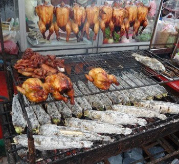 Salt Encrusted Fish and Barbeque Chicken on the street in Bangkok, Thailand
