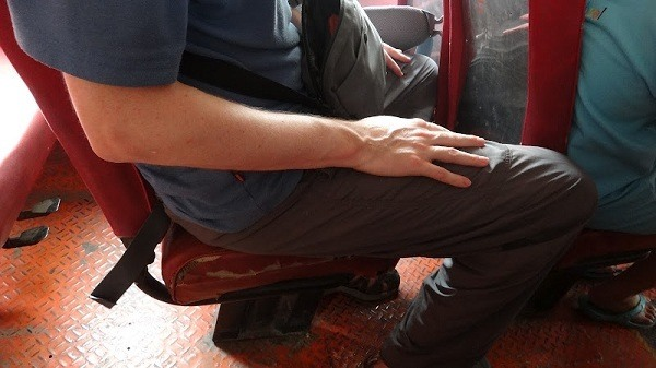 The bus ride from Chiang Rai to Chiang Khong - Andrew forgot to pack his big legs away