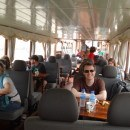 Andrew hanging out in our booth on the Nagi of Mekong long boat