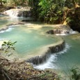 Kuang Si Waterfall is a beautiful series of dozens of connect pools, many of which you can swim in. It's about 30 minutes drive outside of Luang Prabang. Beautiful blue water, Laotian countryside, surprise sun bears. What more could you want? Getting transport out to the waterfalls is no problem....